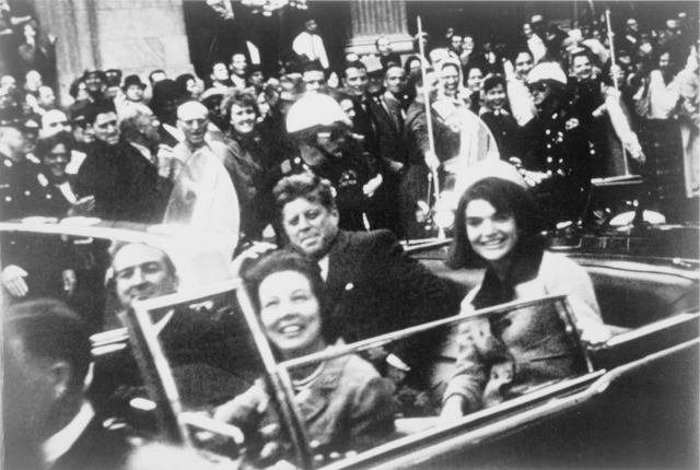 President John F. Kennedy motorcade, Dallas, Texas, Friday, November 22, 1963. Also in the limousine are Jackie Kennedy, Texas Governor John Connally and his wife, Nellie.