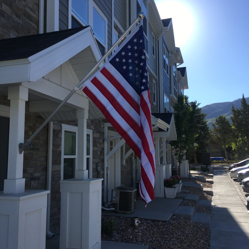 Flag of the United States of American hanging in front of a townhouse. Photo credit Michael James Fitzgerald, 31 May 2021.
